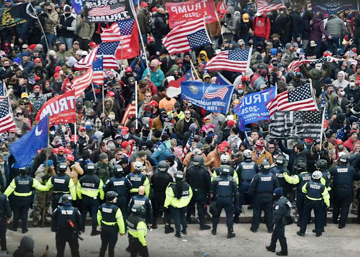 Trump supporters storm the US Capitol in Washington, DC on January 6, 2021.