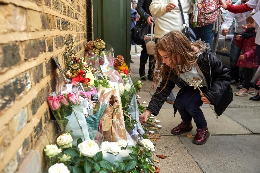Well-wishers leave floral tributes in memory of slain French au pair Sophie Lionnet outside a residential property in Wimbledon, west London, in 2017 (AFP Photo/NIKLAS HALLE'N)