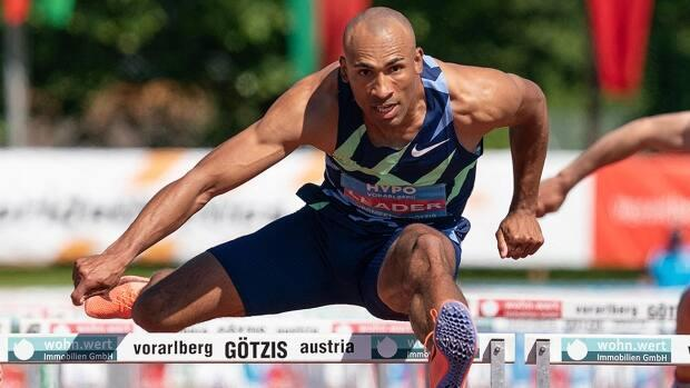 Damian Warner of London, Ont., captured the 110-metre hurdles in 13.36 seconds on Sunday en route to becoming the first person to win six Hypo Meeting decathlon titles in Gotzis, Austria. Warner compiled 8,995 points across 10 events over two days to surpass his Canadian record. (Dietmar Stiplovsek/APA/AFP via Getty Images - image credit)