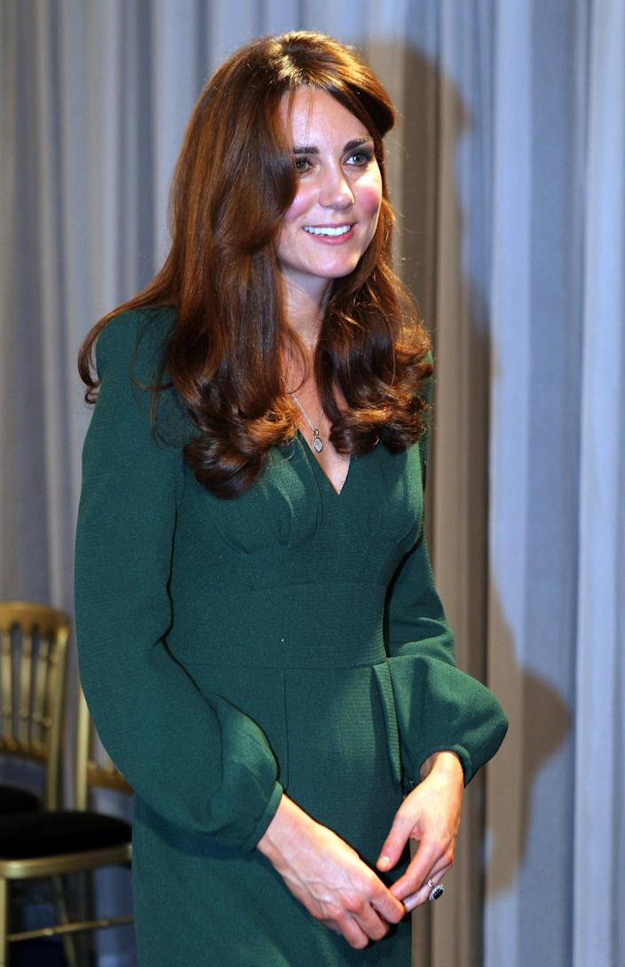 Kate, the Duchess of Cambridge smiles as she attends the BBC Sports Personality of the Year Awards 2012 in London, Sunday Dec. 16, 2012. (AP Photo/David Davies, PA) UNITED KINGDOM OUT: NO SALES: NO ARCHIVE