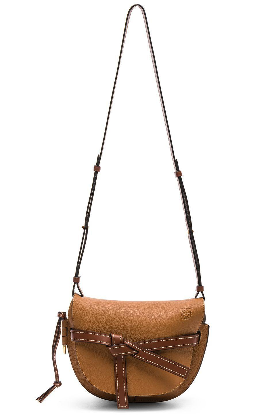 Finally, add a cool bag in shades of tan and brown like this fashion-girl staple from Loewe.