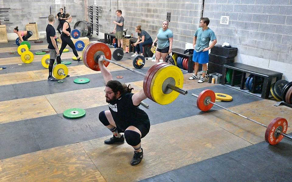 Olympic weightlifter Caine Wilkes originally took up the sport in middle school with the idea that it would help him in football.