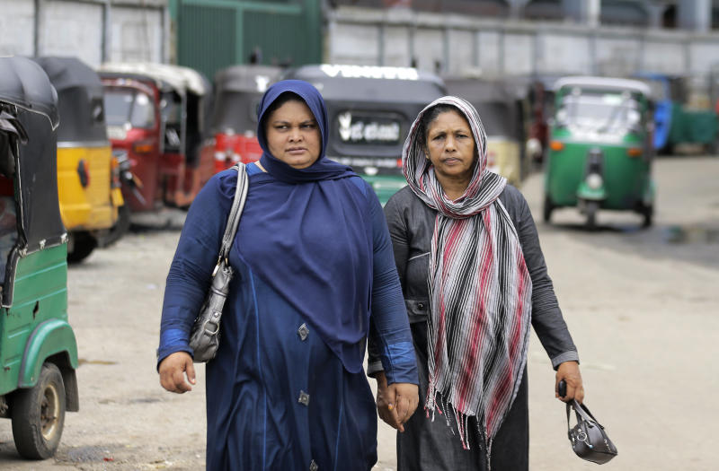 Sri Lankan Muslim women walk in a street in Colombo, Sri Lanka, Tuesday, Aug. 27, 2019. Islamic clerics in Sri Lanka asked Muslim women on Tuesday to continue to avoid wearing face veils until the government clarifies whether they are once again allowed now that emergency rule has ended four months after a string of suicide bomb attacks. (AP Photo/Eranga Jayawardena)
