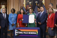 House Speaker Nancy Pelosi, D-Calif., joined by, from left, Rep. David Cicilline, D-R.I., Rep. Val Demings, D-Fla., Rep. Stephanie Murphy, D-Fla., Rep. Darren Soto, D-Fla., and Rep. Debbie Wasserman Schultz, D-Fla., holds the bill to create the National Pulse Memorial to honor the victims of the 2016 mass shooting at the Pulse nightclub in Orlando, at the Capitol in Washington, Wednesday, June 16, 2021. The shooting was the deadliest attack on the LGBTQ community in U.S. history and left 49 people dead. (AP Photo/J. Scott Applewhite)