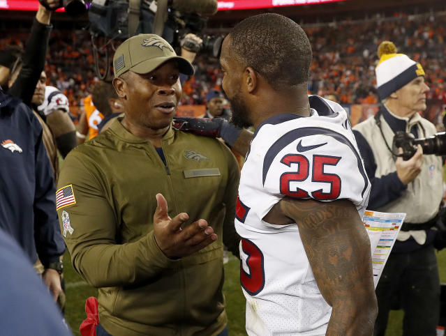 Denver Broncos head coach Vance Joseph talks with Houston Texans strong safety Kareem Jackson (25) after an NFL football game, Sunday, Nov. 4, 2018, in Denver. The Texans won 19-17. (AP Photo/David Zalubowski)