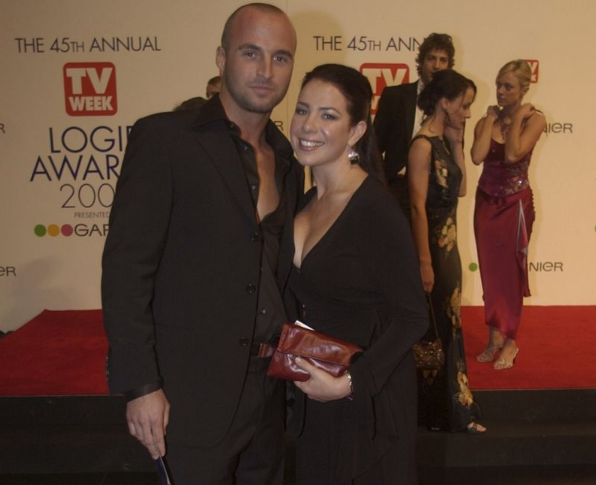 A photo of Home and Away stars Ben Unwin and Kate Ritchie on the red carpet for the 45th Annual TV Week Logie Awards 2003 held at the Crown Casino, Melbourne, Australia.