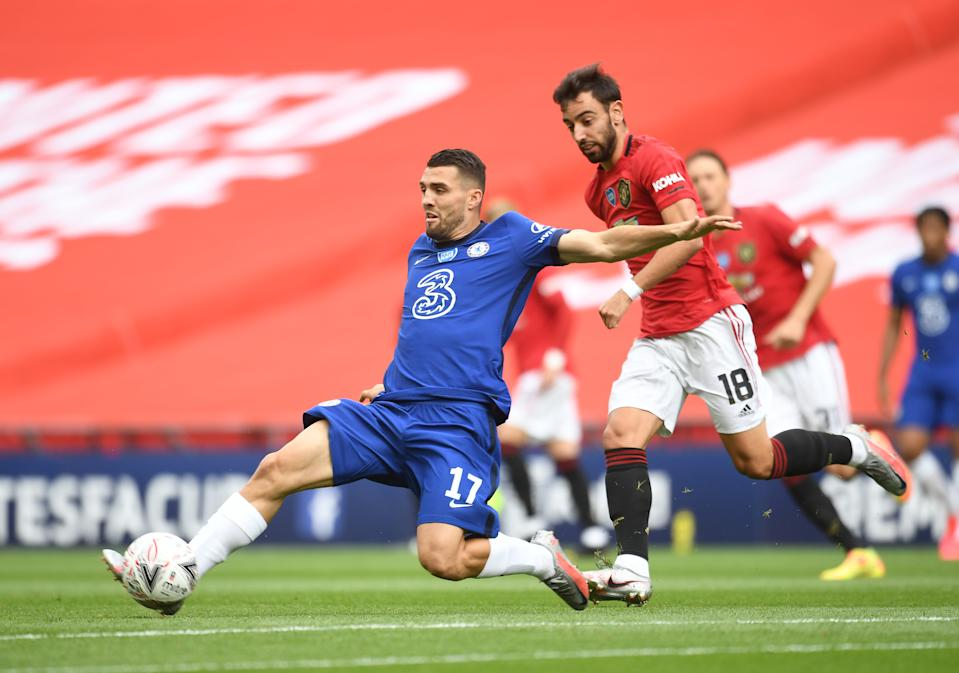 Chelsea's Mateo Kovacic in action with Manchester United's Bruno Fernandes.