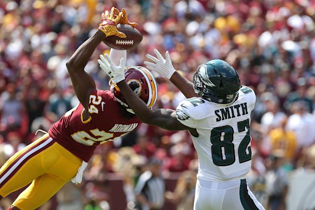 <p>Washington Redskins cornerback Josh Norman (24) attempts to intercept a pass intended for Philadelphia Eagles wide receiver Torrey Smith (82) in the first quarter at FedEx Field. Mandatory Credit: Geoff Burke-USA TODAY Sports </p>