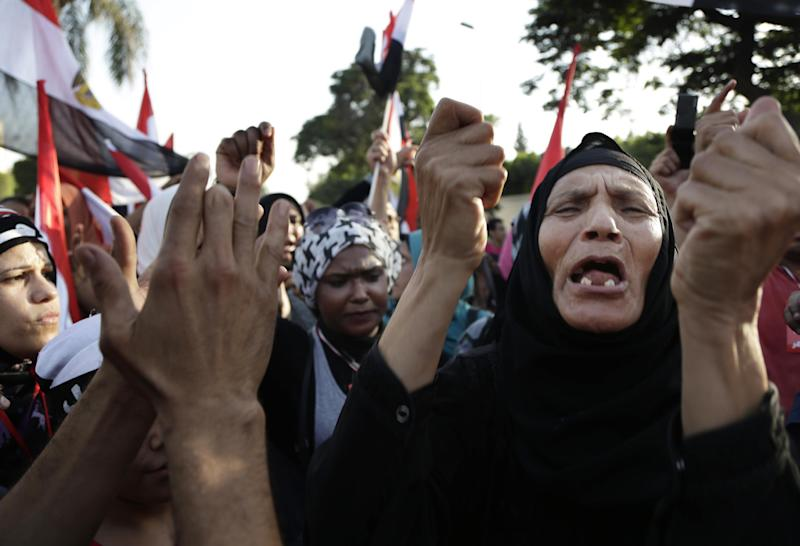 Egyptian protesters chant against the Muslim Brotherhood and Egyptian President Mohammed Morsi during a protest in front of the Ministry of Defense, in Cairo, Egypt, Wednesday, June 26, 2013. In abstract terms, protests planned for Sunday, June 30, 2013 aiming to force out Egypt's Islamist president violate a basic principle of democracy: If an election has been held, all must respect the results, otherwise it's political chaos. Supporters of President Mohammed Morsi have been angrily making that argument for days. Those behind the protests insist he lost the legitimacy of that election victory by power grabs and missteps. (AP Photo/Hassan Ammar)