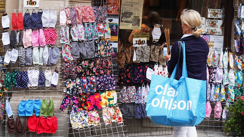 A woman stops to look at fabric face masks on sale in a shop in Stockholm, Sweden, on August 31, 2020. (Tom Little/AFP via Getty Images)