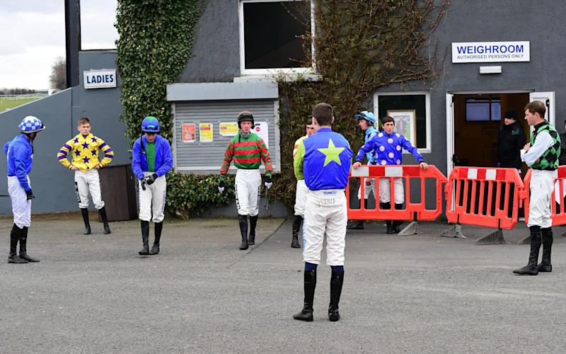 Jockeys keep their distance at Thurles Racecourse in Ireland on Saturday - Get in, race, get out – how horse racing will look behind closed doors - PA