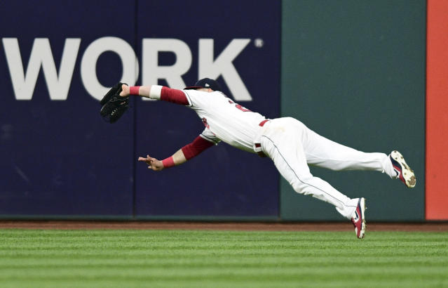 Jason Kipnis makes a flying catch for the Indians in centerfield. (AP)