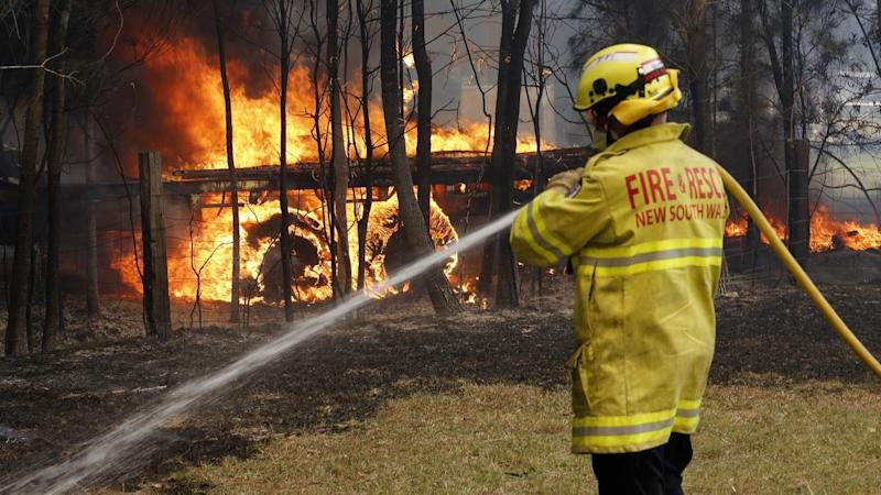 The PM and NSW premier warned that the worse was yet to come after fires claimed lives and homes