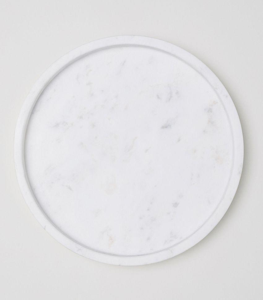 Use this tray on your bathroom vanity, on the kitchen counter, or anywhere else you need to corral a few chic items.