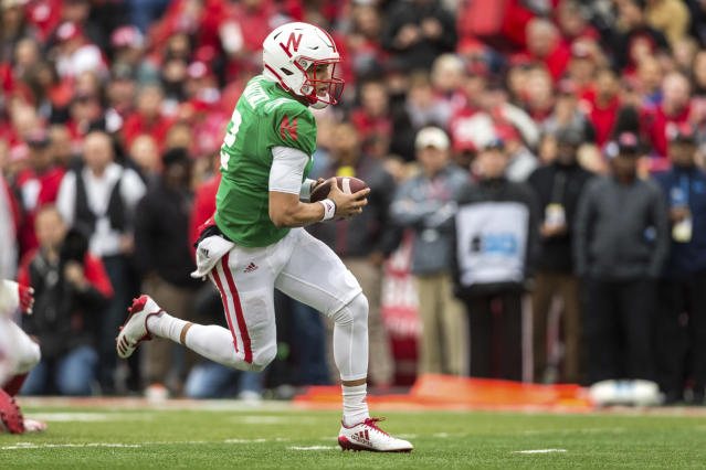 Nebraska red team quarterback Adrian Martinez (2) runs the ball for a touchdown during the Red/White spring football game in Lincoln. (AP Photo/John Peterson)