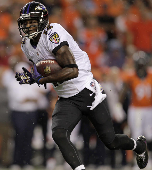 during the first half of an NFL football Baltimore Ravens wide receiver Jacoby Jones (12) runs the ball against the Denver Broncos game, Thursday, Sept. 5, 2013, in Denver. (AP Photo/Joe Mahoney)
