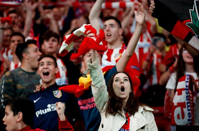 Soccer Football - Europa League Final - Atletico Madrid fans watch the final - Olympique de Marseille vs Atletico Madrid - Wanda Metropolitano, Madrid, Spain - May 16, 2018 Atletico Madrid fans celebrate REUTERS/Juan Medina