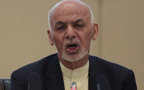 Afghan President Ashraf Ghani has moved to open talks with Taliban forces - Credit: SHAH MARAI/AFP