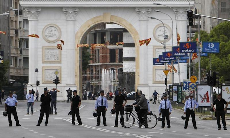 Police officers block the street in front of the parliament building in Skopje on Friday