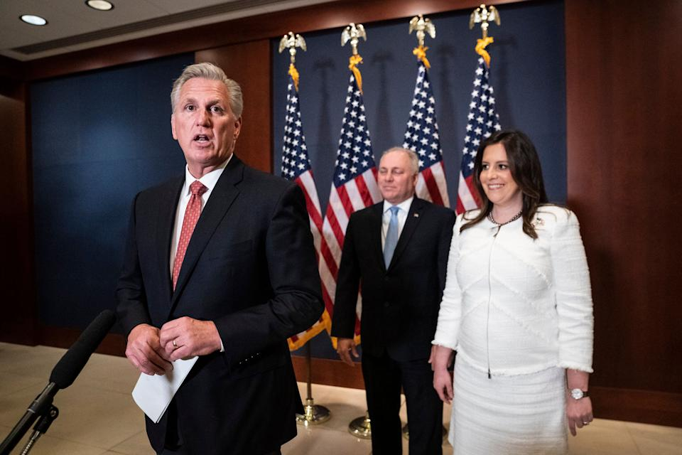 House Minority Leader Kevin McCarthy (R-Calif.) speaks with Rep. Elise Stefanik (R-N.Y.) moments after she was elected chair of the House Republican Conference on May 14. Stefanik replaced Rep. Liz Cheney (R-Wyo.), who was ousted from her leadership role after refusing to go along with former President Donald Trump's lies about the 2020 election. (Photo: Photo by Jabin Botsford/The Washington Post via Getty Images)