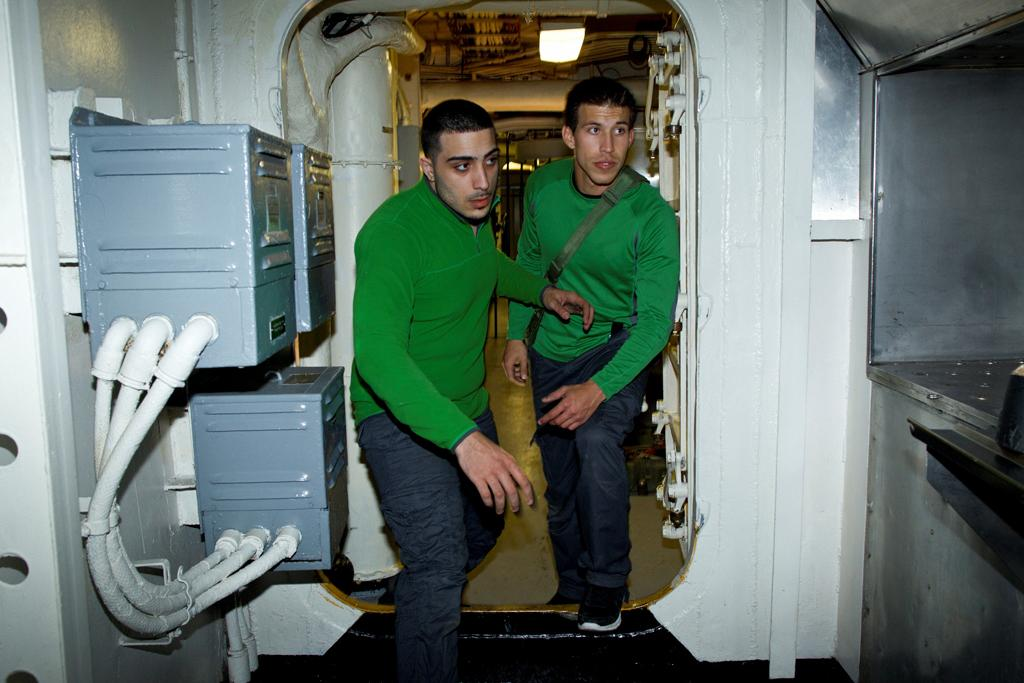 "Contestants Armando and Victor from ""The Great Escape,"" on the aircraft carrier the USS Hornet in Oakland, California."