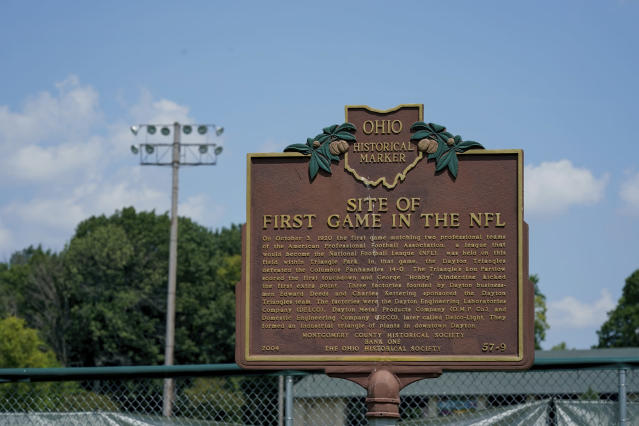 FILE - This July 27, 2019, file photo shows a plaque commemorating the site of the first profession football game in Triangle Park in Dayton, Ohio. (AP Photo/Bryan Woolston, File)