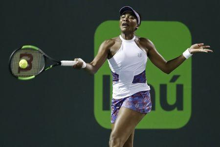 Mar 28, 2018; Key Biscayne, FL, USA; Venus Williams of the United States hits a forehand against Danielle Collins of the United States (not pictured) on day nine at the Miami Open at Tennis Center at Crandon Park. Mandatory Credit: Geoff Burke-USA TODAY Sports