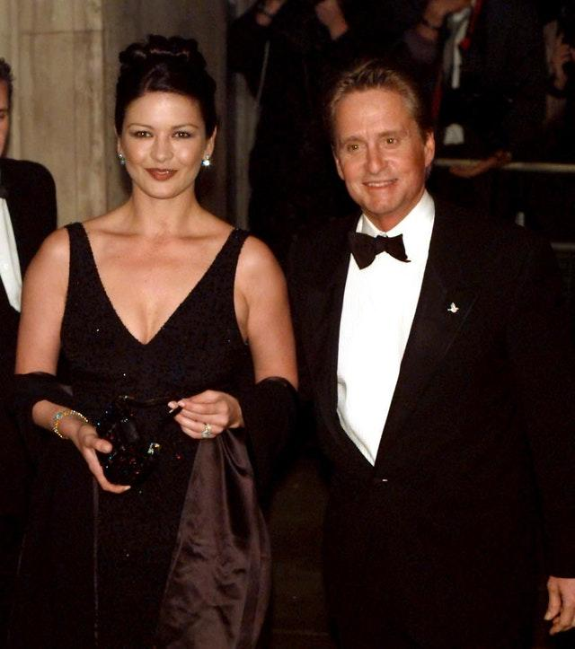 Daughter-in-law Catherine Zeta-Jones and son Michael Douglas (PA)