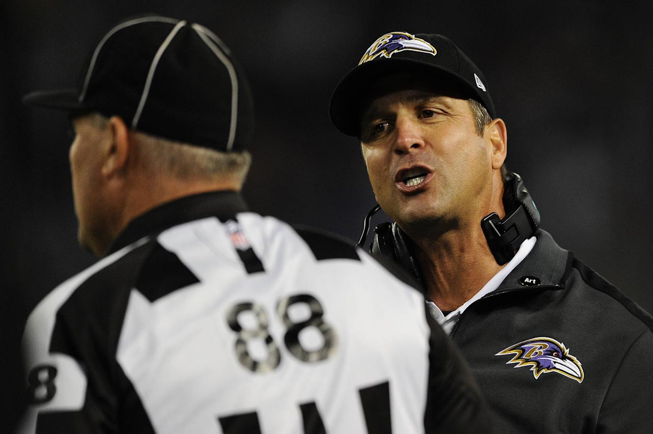 BALTIMORE, MD - SEPTEMBER 23: Head coach John Harbaugh of the Baltimore Ravens argues a call with a replacement referee in the fourth quarter against the New England Patriots at M&T Bank Stadium on September 23, 2012 in Baltimore, Maryland. The Baltimore Ravens won, 31-30. (Photo by Patrick Smith/Getty Images)