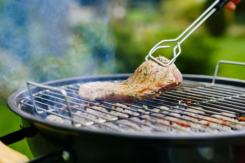 """<p>Direct cooking is when you place meat directly over the flames, which is what most people do when grilling their food. But <a href=""""https://www.ashlandspringshotel.com/weddings-blog/executive-chef-franco-console/"""" rel=""""nofollow noopener"""" target=""""_blank"""" data-ylk=""""slk:executive chef Franco Console"""" class=""""link rapid-noclick-resp"""">executive chef Franco Console</a> of Larks Home Kitchen Cuisine at <a href=""""https://www.ashlandspringshotel.com/"""" rel=""""nofollow noopener"""" target=""""_blank"""" data-ylk=""""slk:Ashland Springs Hotel"""" class=""""link rapid-noclick-resp"""">Ashland Springs Hotel</a> in Oregon, tells Woman's Day he prefers indirect cooking, especially with his charcoal grill. </p><p>""""It's my go-to trick for chicken or anything with a lot of fat such as tri-tip, brisket, whole chickens and sausages,"""" he says. """"I put all the charcoal to the left of the grill, set the meat to the right and put the lid on. It's the best way to get the indirect charcoal and barbecue flavor, without charring the meat. It also allows the meat to baste in its own fat.""""</p>"""