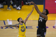 Sacramento Kings guard Buddy Hield (24) shoots a 3-point shot over Golden State Warriors guard Mychal Mulder (15) during the second half of an NBA basketball game on Sunday, April 25, 2021, in San Francisco. (AP Photo/Tony Avelar)
