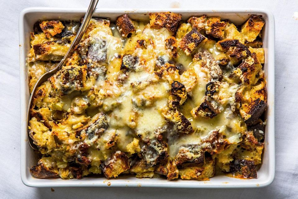 """This holiday-worthy recipe was inspired by bread pudding and ended up somewhere between a strata, a gratin, and a traditional Thanksgiving stuffing. <a href=""""https://www.epicurious.com/recipes/food/views/cheesy-sausage-and-sage-stuffing?mbid=synd_yahoo_rss"""" rel=""""nofollow noopener"""" target=""""_blank"""" data-ylk=""""slk:See recipe."""" class=""""link rapid-noclick-resp"""">See recipe.</a>"""