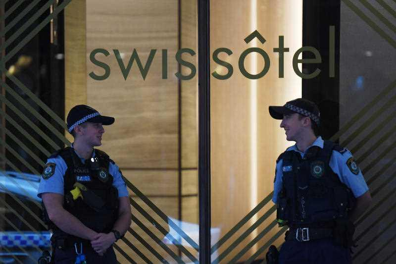 NSW Police stand guard outside the Swissotel Hotel in Market Street, Sydney.