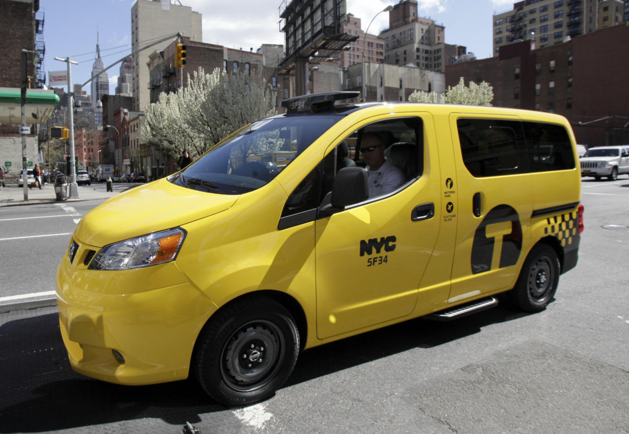 A prototype of the Nissan NV 200 New York City taxi is off-loaded from a truck, in New York, Monday, April 2, 2012. The iconic New York City taxi has gotten a passenger-friendly makeover from Nissan with low-annoyance horns, USB chargers and germ-fighting seats to cut down on bad odors. Medallion owners will be required to buy the Nissan NV 200 at a cost of about $29,000 starting in late 2013. (AP Photo/Richard Drew)
