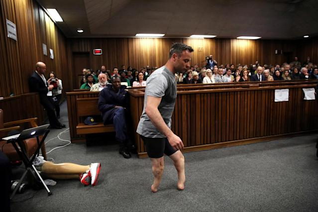 Paralympic gold medalist Oscar Pistorius walks across the courtroom without his prosthetic legs during the third day of the resentencing hearing for the 2013 murder of his girlfriend Reeva Steenkamp, at Pretoria High Court, South Africa June 15, 2016. REUTERS/Siphiwe Sibeko/File Photo