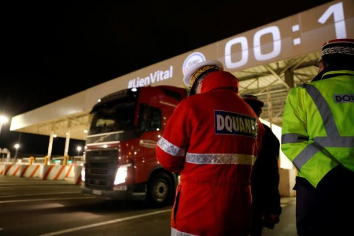 The first trucks leave Eurotunnel's new customs border in Calais following Britain's EU exit