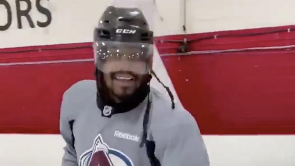 Marshawn Lynch playing hockey