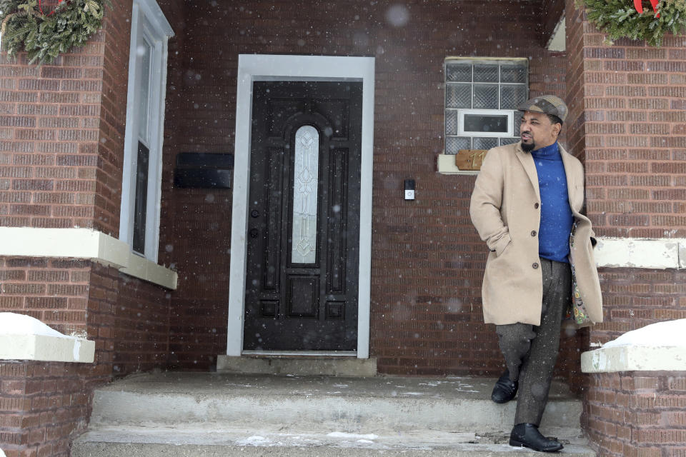 Willie Preston stands outside of his home in Chicago's South Side, Wednesday, Feb. 10, 2021. Preston and his wife, Brittany, have managed the online schedules of their six children, often with everyone around the dining room table. His youngest daughter starts school Thursday with other pre-K and special education students and believes the district has done a good job with cleaning and social distancing measures. (AP Photo/Shafkat Anowar)