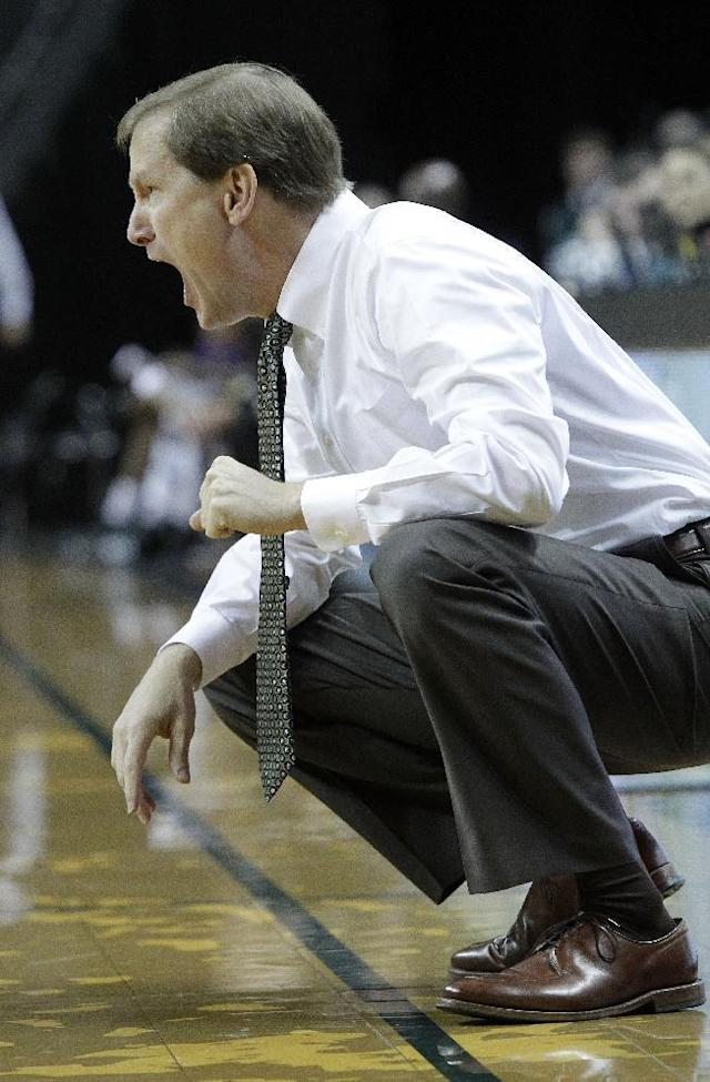 Oregon coach Dana Altman yells from the bench during the first half of an NCAA college basketball game against Western Carolina in Eugene, Ore., Wednesday, Nov. 13, 2013. (AP Photo/Don Ryan)