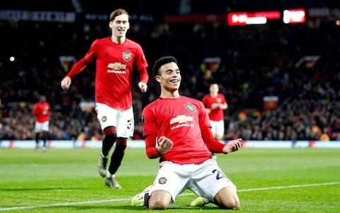 Manchester United's Mason Greenwood celebrates his sides fourth goal during the UEFA Europa League match at Old Trafford, Manchester. PA Photo. Picture date: Thursday December 12, 2019. See PA story SOCCER Man Utd - Credit: PA