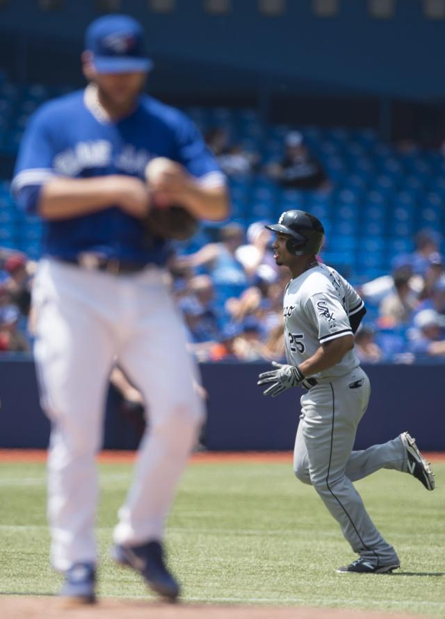 Chicago White Sox's Moises Sierra, right, rounds the bases past Toronto Blue Jays starting pitcher Mark Buehrle following his solo home run in the fourth inning of a baseball game in Toronto on Sunday, June 29, 2014. (AP Photo/The Canadian Press, Darren Calabrese)