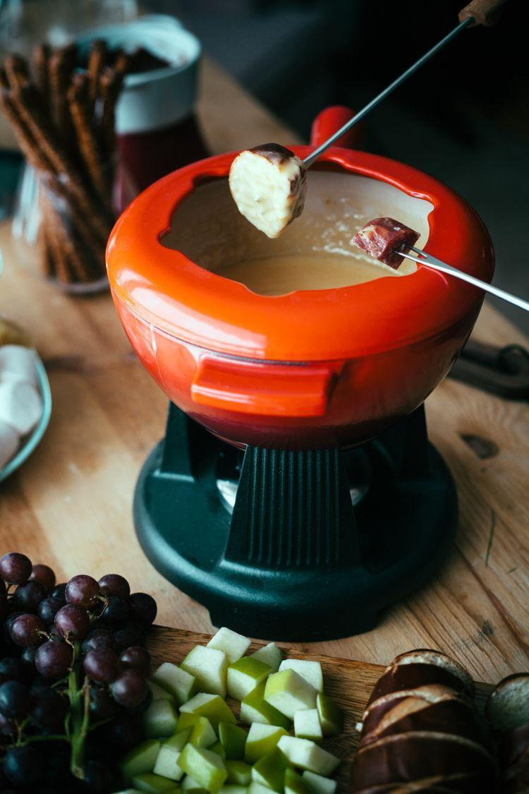 """<p>Like we really need to convince you to gather around a pot of melted cheese at your next get-together.</p><p><a class=""""link rapid-noclick-resp"""" href=""""https://www.amazon.com/Artestia-Electric-Ceramic-Fondue-Forks/dp/B06XPSH7BD/ref=sxin_3_ac_d_pm?ac_md=2-1-QmV0d2VlbiAkNTAgYW5kICQ3NQ%3D%3D-ac_d_pm&keywords=Fondue+Set&pd_rd_i=B06XPSH7BD&pd_rd_r=69373b94-290e-4136-b7eb-d8a2d7da9ba7&pd_rd_w=7ZKZZ&pd_rd_wg=BZCrJ&pf_rd_p=24d053a8-30a1-4822-a2ff-4d1ab2b984fc&pf_rd_r=TDDGQF4R8TZP00DJAKYD&psc=1&qid=1569853463&s=home-garden&tag=syn-yahoo-20&ascsubtag=%5Bartid%7C10055.g.794%5Bsrc%7Cyahoo-us"""" rel=""""nofollow noopener"""" target=""""_blank"""" data-ylk=""""slk:SHOP FONDUE SETS"""">SHOP FONDUE SETS</a></p><p><em><a href=""""http://mynameisyeh.com/mynameisyeh/2015/1/smoked-gouda-fondue-a-fondue-party"""" rel=""""nofollow noopener"""" target=""""_blank"""" data-ylk=""""slk:Get the recipe from My Name is Yeh »"""" class=""""link rapid-noclick-resp"""">Get the recipe from My Name is Yeh »</a></em></p><p><strong>RELATED: </strong><a href=""""https://www.goodhousekeeping.com/cooking-tools/cookware-reviews/g34108966/best-fondue-pots/"""" rel=""""nofollow noopener"""" target=""""_blank"""" data-ylk=""""slk:8 Best Fondue Pots for 2020, According to Kitchen Experts"""" class=""""link rapid-noclick-resp"""">8 Best Fondue Pots for 2020, According to Kitchen Experts</a></p>"""