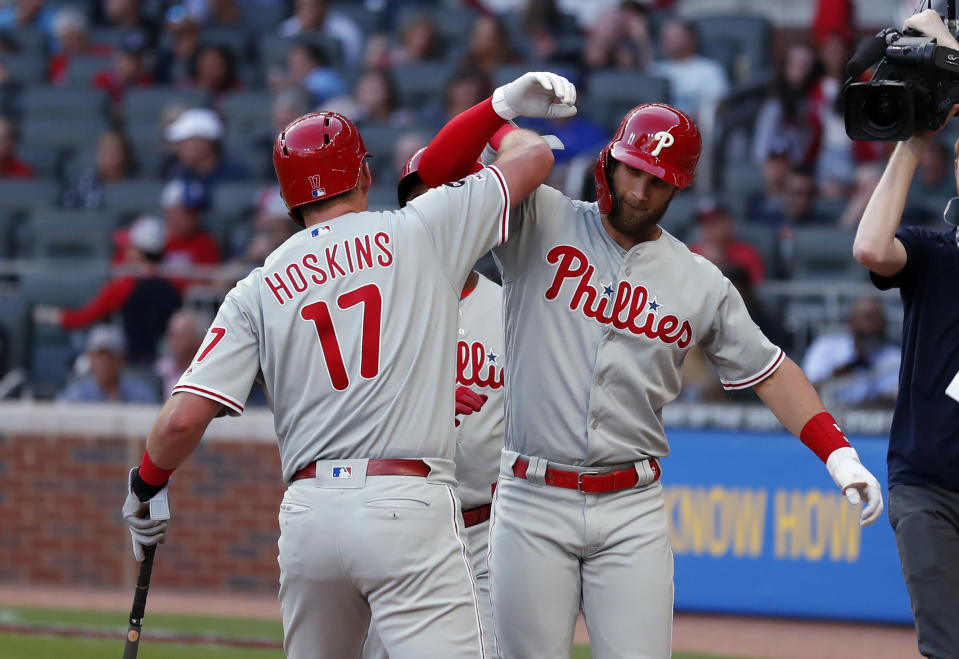 Philadelphia Phillies' Bryce Harper (3) celebrates with Rhys Hoskins (17) after hitting a two-run home run during the third inning of the team's baseball game against the Atlanta Braves on Friday, June 14, 2019, in Atlanta. (AP Photo/John Bazemore)