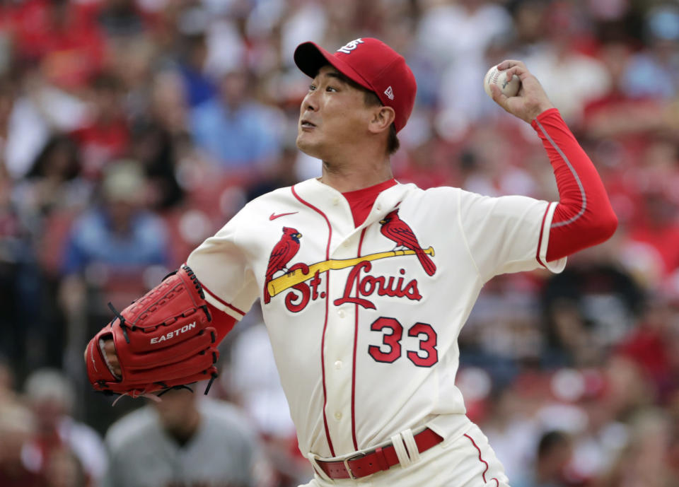 St. Louis Cardinals starting pitcher Kwang Hyun Kim throws during the first inning of the team's baseball game against the San Francisco Giants, Saturday, July 17, 2021, in St. Louis. (AP Photo/Tom Gannam)