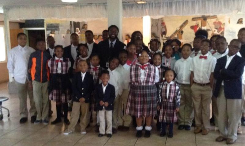 Charles Woods with a class of students he taught about the civil rights movement