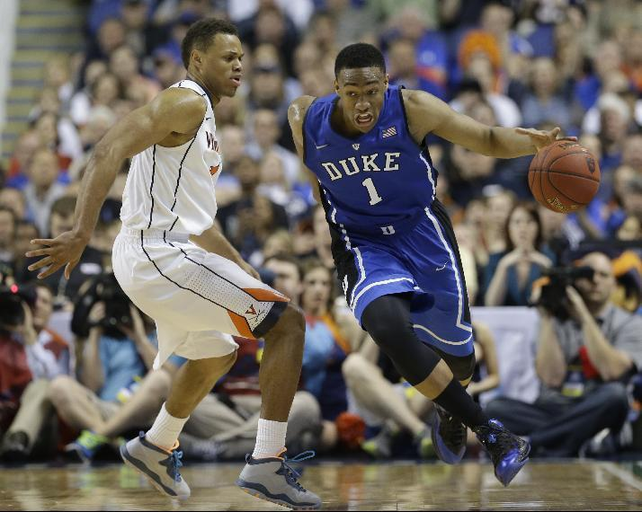 FILE - In this March 16, 2014 file photo, Duke's Jabari Parker, right, drives past Virginia's Justin Anderson during the second half of an NCAA college basketball game in the championship of the Atlantic Coast Conference tournament in Greensboro, N.C. Parker is entering the NBA draft, and there's a strong chance he'll be the No. 1 pick. (AP Photo/Gerry Broome, File)