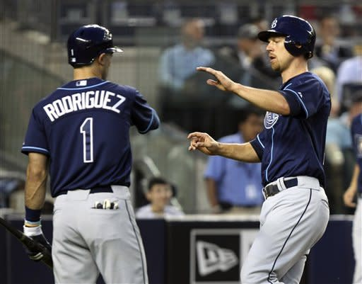 Tampa Bay Rays' Ben Zobrist, right, is greeted by Sean Rodriguez after scoring on a sacrifice fly by B.J. Upton during the third inning of the baseball game against the New York Yankees, Thursday, June 7, 2012, at Yankee Stadium in New York. (AP Photo/Seth Wenig)