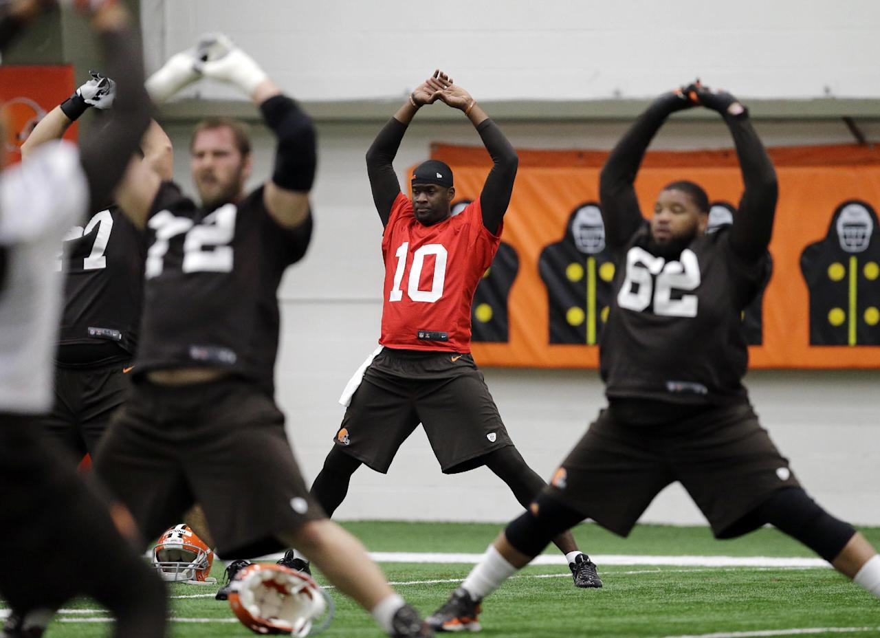 Cleveland Browns quarterback Vince Young (10) stretches before a voluntary minicamp workout at the NFL football team's facility in Berea, Ohio Tuesday, April 29, 2014. (AP Photo/Mark Duncan)