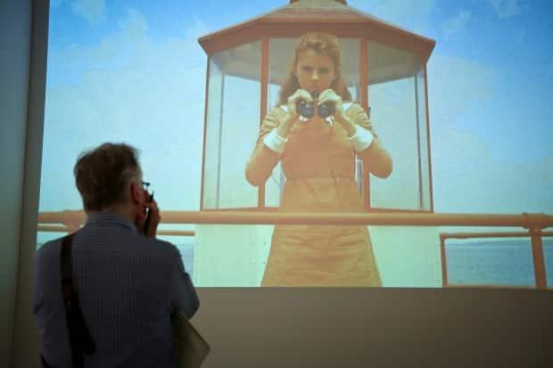 In a scene from the 2012 film Moonrise Kingdom, filmmaker Wes Anderson pays homage to Colville with this scene, projected onto a wall at the AGO, reminiscent of the 1965 painting To Prince Edward Island.