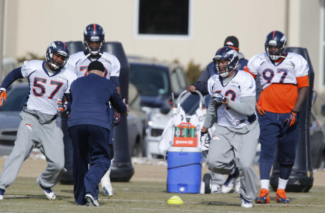 Denver Broncos defensive ends Jeremy Mincey (57) and Hall Davis (72) workout during NFL football practice at the team's training facility in Englewood, Colo., on Thursday, Jan. 16, 2014. The Broncos are scheduled to host the New England Patriots on Sunday in the AFC championship. (AP Photo/Ed Andrieski)